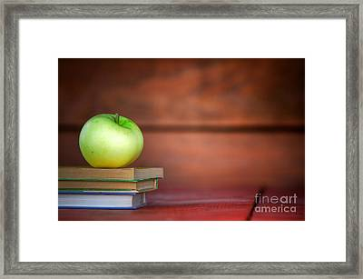 Apple On Pile Of Books Framed Print by Michal Bednarek
