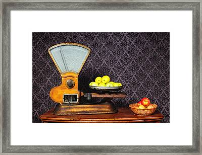 Apples On The Scale Framed Print