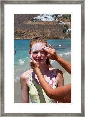Applying Sun Cream Framed Print