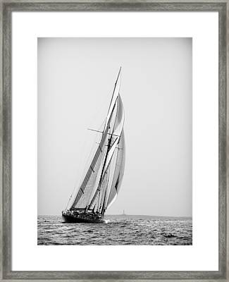 A Tall Ship In Mediterranean Water Approaching To Lighthouse Of Isla Del Aire - Menorca Framed Print