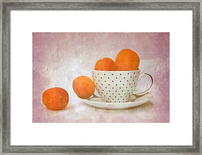 Apricots In A Cup Framed Print by Angela Bruno