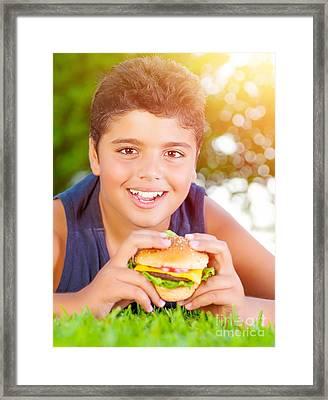 Arabic Boy Eating Burger Outdoors Framed Print