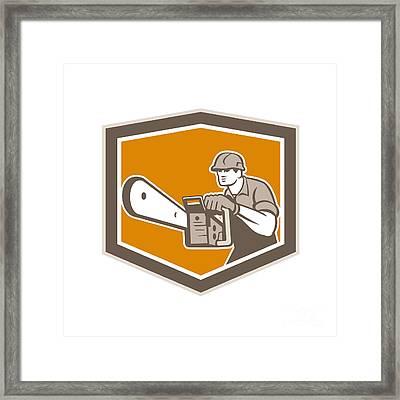 Arborist Lumberjack Operating Chainsaw Shield Framed Print by Aloysius Patrimonio