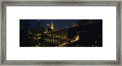 Arch Bridge And Buildings Lit Framed Print by Panoramic Images