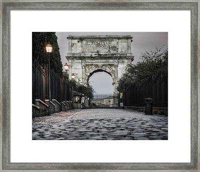 Arch Of Titus Morning Glow Framed Print by Joan Carroll