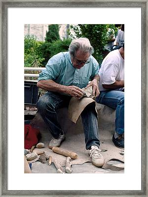 Archaeologist Knapping Flint Stone Tool Framed Print by Philippe Plailly