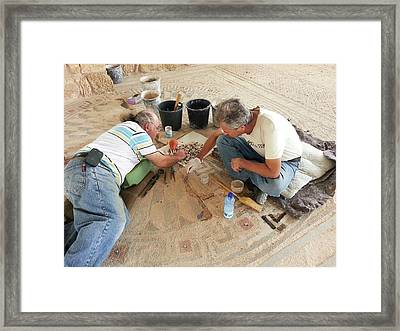 Archeologists Restore A Mosaic Floor Framed Print