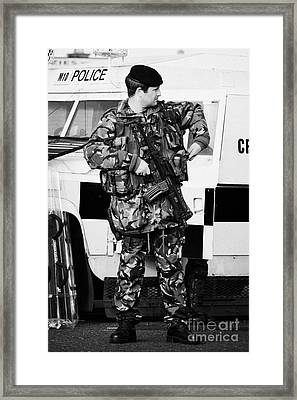 Armed British Soldier At Psni Landrover On Crumlin Road At Ardoyne Shops Belfast 12th July Framed Print by Joe Fox