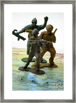 Armed Toy Soliders On Iraq Map Framed Print by Amy Cicconi