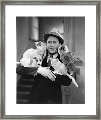 Armful Of Cats And Dogs Framed Print by Underwood Archives