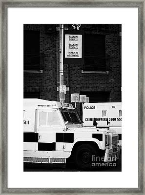 Armoured Psni Land Rovers Under Protest Sign Banner On Crumlin Road At Ardoyne  Framed Print
