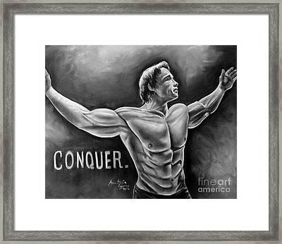 Arnold Schwarzenegger / Conquer Framed Print