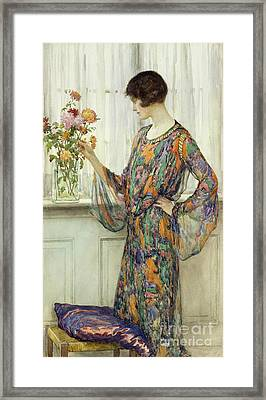Arranging Flowers Framed Print by William Henry Margetson