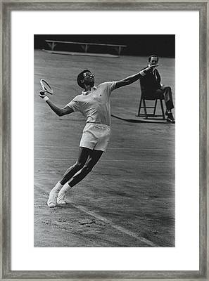 Arthur Ashe Playing Tennis Framed Print by Jack Robinson