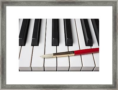 Artist Brush On Piano Keys Framed Print by Garry Gay