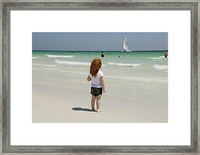 As The Sail Boat Rolls By Framed Print by Charles Beeler