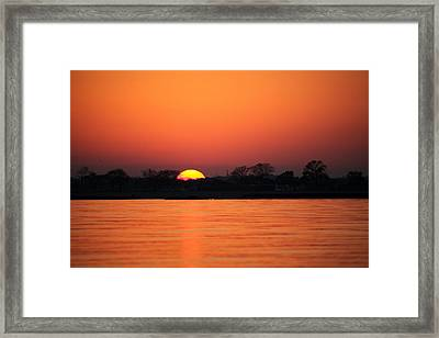 As The Sun Goes Down  Framed Print by Karol Livote