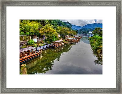 Asian Pleasure Boats Wait On The River Hozu In Japan Framed Print by Laura Palmer