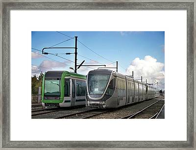 Assembled Trams Awaiting Delivery Framed Print by Andrew Wheeler