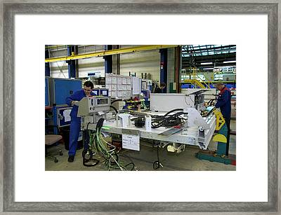 Assembling Electric Circuits For Trams Framed Print by Andrew Wheeler