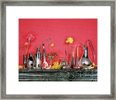 Assorted Silverware On A Mantelpiece Framed Print by James Wojcik