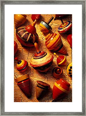 Assorted Toy Tops Framed Print by Garry Gay