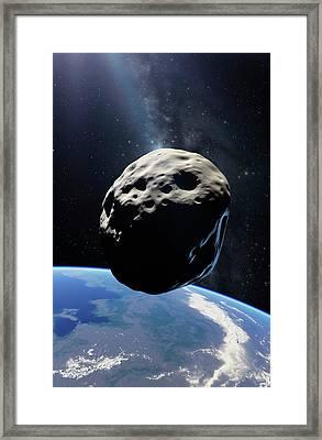 Asteroid Passing Earth Framed Print by Detlev Van Ravenswaay