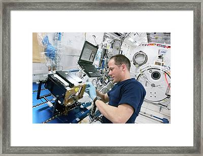 Astronaut Cleaning Iss Lab Equipment Framed Print