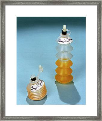 Astronaut Drinks Containers Framed Print by Nasa