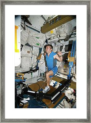 Astronaut Exercising On The Iss Framed Print