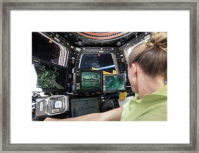 Astronaut In Iss Robotics Workstation Framed Print