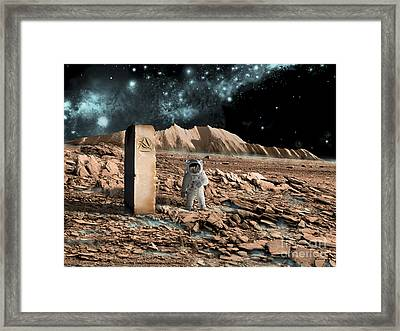 Astronaut On An Alien World Discovers Framed Print