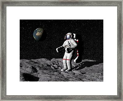 Astronaut On Moon With Earth Framed Print by Elena Duvernay