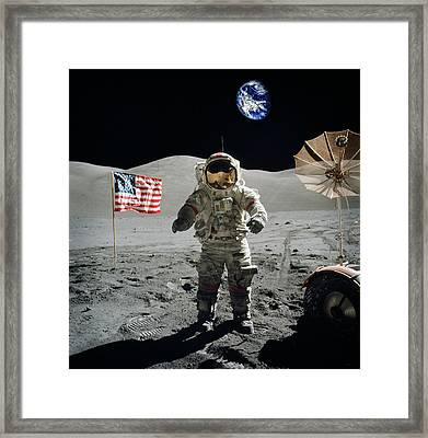 Astronaut On The Lunar Surface Earth On The Background Framed Print