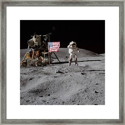 Astronaut Saluting The American Flag During Apollo 16 Mission Framed Print by Celestial Images