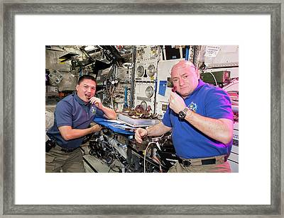 Astronauts Eating Food Grown In Space Framed Print by Nasa