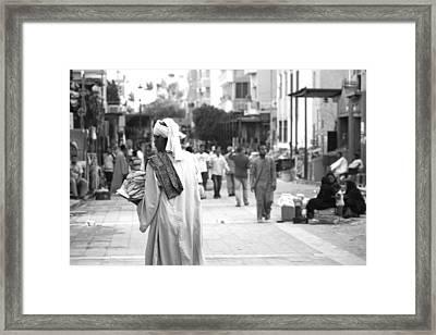 Aswan Street Seller Framed Print by Laura Hiesinger