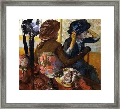 At Milliner's Framed Print by Edgar Degas