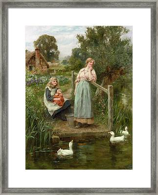 At The Duck Pond Framed Print by Henry King