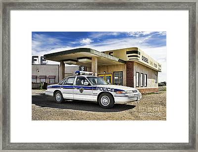 At The Pumps Framed Print by Nicholas Kokil