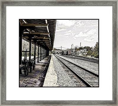 At The Station Framed Print by Mike Waddell