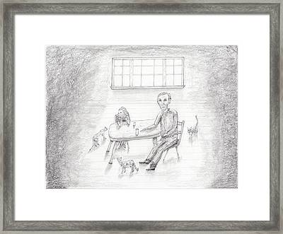 At The Table Framed Print