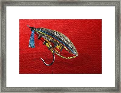 Atlantic Salmon Dry Fly On Red Framed Print by Serge Averbukh