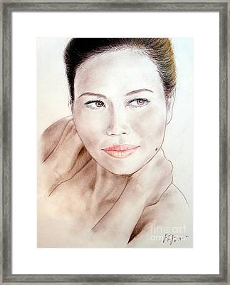 Attractive Asian Woman With Her Hair Pulled Back Framed Print by Jim Fitzpatrick