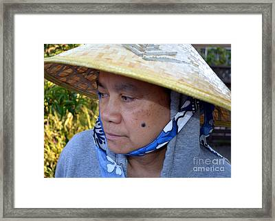 Attractive Filipina Woman With A Mole On Her Cheek And Wearing A Conical Hat Framed Print by Jim Fitzpatrick