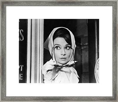 Audrey Hepburn In Charade  Framed Print