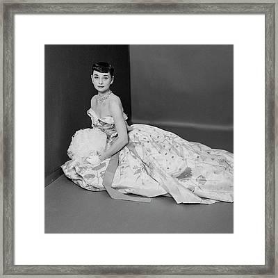 Audrey Hepburn Wearing An Adrian Dress Framed Print by Richard Rutledge
