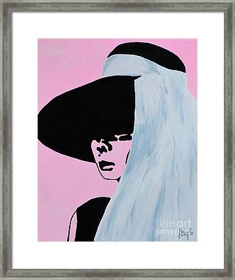 Audrey Hepburn Wears A Hat Framed Print by Alys Caviness-Gober
