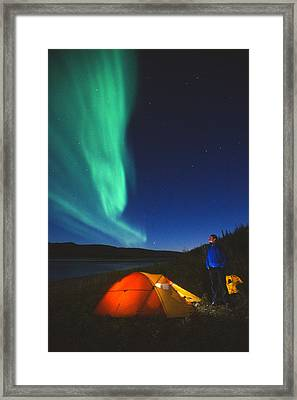 Aurora Borealis Above A Tent And Camper Framed Print by Peter Mather