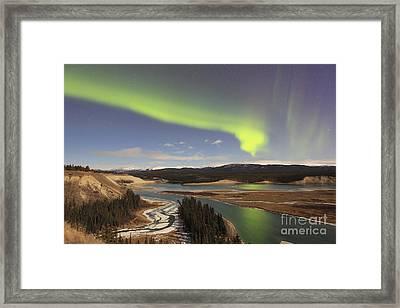 Aurora Borealis Over The Yukon River Framed Print